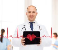 Smiling male doctor with stethoscope and tablet pc Stock Photo
