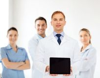 Smiling male doctor with tablet pc Royalty Free Stock Image
