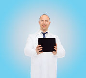Smiling male doctor with tablet pc Royalty Free Stock Photo
