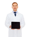 Smiling male doctor with tablet pc Stock Image