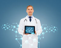 Smiling male doctor with tablet pc and stethoscope Stock Images