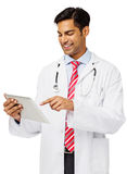 Smiling Male Doctor Using Digital Tablet. Isolated over white background. Vertical shot Stock Photography