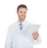 Smiling male doctor using digital tablet Royalty Free Stock Images