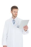 Smiling male doctor using digital tablet Royalty Free Stock Photo