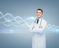 Smiling male doctor in white coat and dna molecule Royalty Free Stock Images