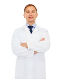 Smiling male doctor in white coat. Healthcare, profession and medicine concept - smiling male doctor in white coat over white background Stock Image