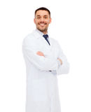Smiling male doctor in white coat Stock Photos