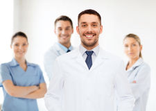 Smiling male doctor in white coat Stock Photography