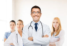 Smiling male doctor in white coat at hospital Stock Photography