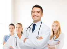 Smiling male doctor in white coat at hospital Stock Photos