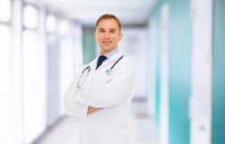 Smiling male doctor in white coat with stethoscope Royalty Free Stock Image