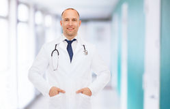 Smiling male doctor in white coat with stethoscope Stock Image