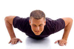 Smiling Male Doing Push Ups Stock Photography