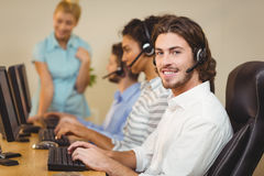 Smiling male employee with coworkers Stock Images