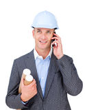 Smiling male engineer talking on phone Royalty Free Stock Image