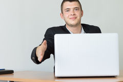 Smiling Male Executive Showing Handshake Gesture royalty free stock photos