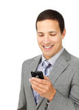 Smiling male executive using a mobile phone Royalty Free Stock Images