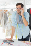 Smiling male fashion designer using mobile phone Royalty Free Stock Photography