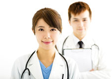 Smiling male and female doctors standing together Royalty Free Stock Images