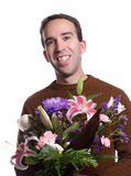 Smiling Male Florist. A smiling male florist is holding a lily bouquet, isolated against a white background Royalty Free Stock Photos
