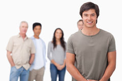 Smiling male with friends behind him Royalty Free Stock Photography