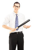 Smiling male with glasses and tie holding a baseball bat Stock Photography