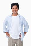 Smiling male with hands on his hip. Against a white background Stock Photo