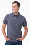 Smiling male with hands in his pockets Stock Image