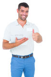 Smiling male handyman with clipboard gesturing thumbs up Royalty Free Stock Photography