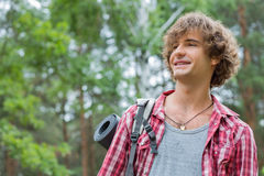 Smiling male hiker looking away in forest Royalty Free Stock Image