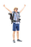 Smiling male hiker with raised hands gesturing happiness Stock Images
