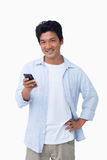 Smiling male with his cellphone Stock Photography