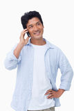 Smiling male on his mobile phone Stock Images