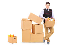 Smiling male holding a box Royalty Free Stock Photo