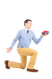 Smiling male holding a gift box Royalty Free Stock Image
