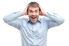 Smiling male holding his head Stock Photos