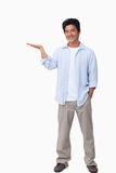 Smiling male holding his palm up Royalty Free Stock Photo