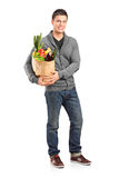 Smiling male holding a paper bag Stock Photo