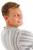 Smiling male looking backward Royalty Free Stock Photo