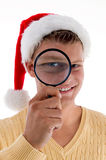 Smiling male looking through lens Stock Photo