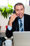 Smiling male manager attending clients call Royalty Free Stock Photo