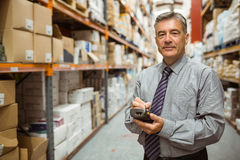 Smiling male manager using handheld Stock Photos