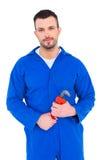 Smiling male mechanic holding monkey wrench Royalty Free Stock Image