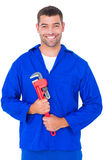 Smiling male mechanic holding monkey wrench Stock Photos