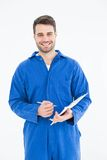Smiling male mechanic writing on clipboard. Portrait of smiling male mechanic writing on clipboard on white background Stock Photos
