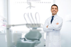 Smiling male middle aged dentist royalty free stock images