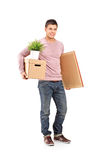 Smiling male moving into a new home Royalty Free Stock Photo