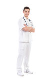 Smiling male nurse posing with arms crossed Royalty Free Stock Images