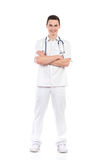 Smiling male nurse posing with arms crossed Stock Image