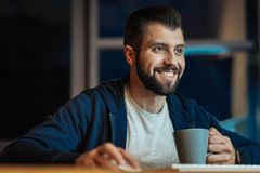 Smiling male person working at night Stock Image